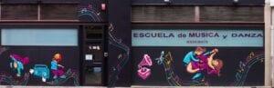 Graffiti comercial en Pamplona - Mural exterior en escuela de música en Pamplona