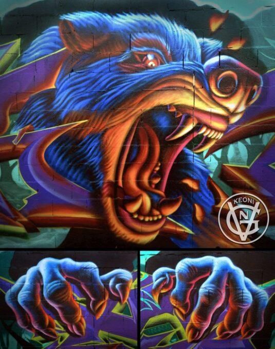 Mural figurativo de lobo en escorzo.