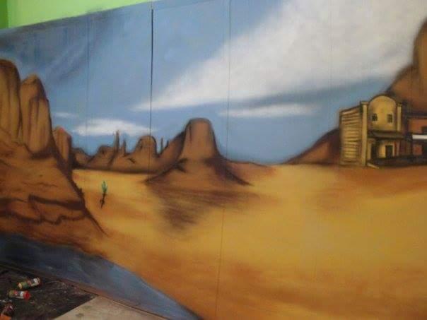 Graffiti: Escenografía viejo oeste sobre cartón