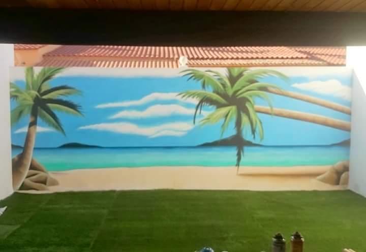 Mural con Paisaje de playa en la terraza