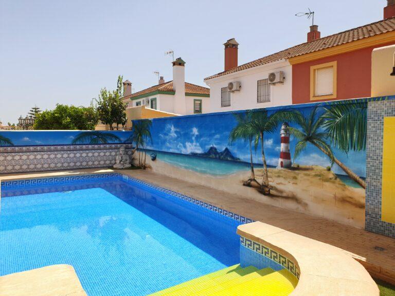 Graffiti mural paisaje de playa con faro