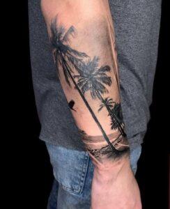 Catálogo de Tatuajes - Tatuaje de una playa con palmeras