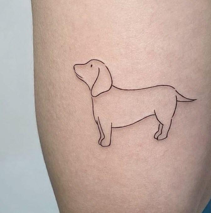 Tatuaje perro en línea fina