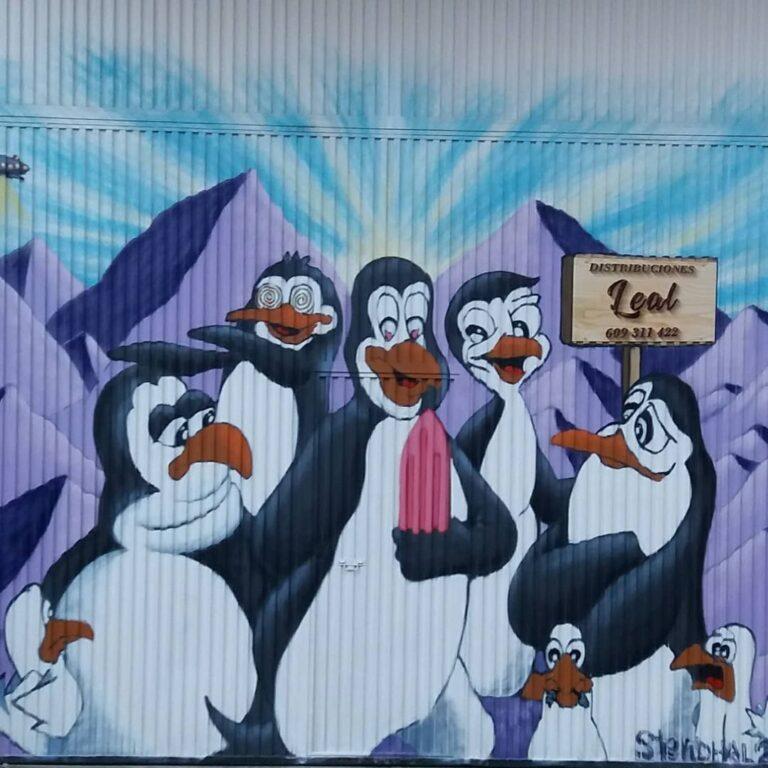 Mural en negocio con dibujo de pingüinos